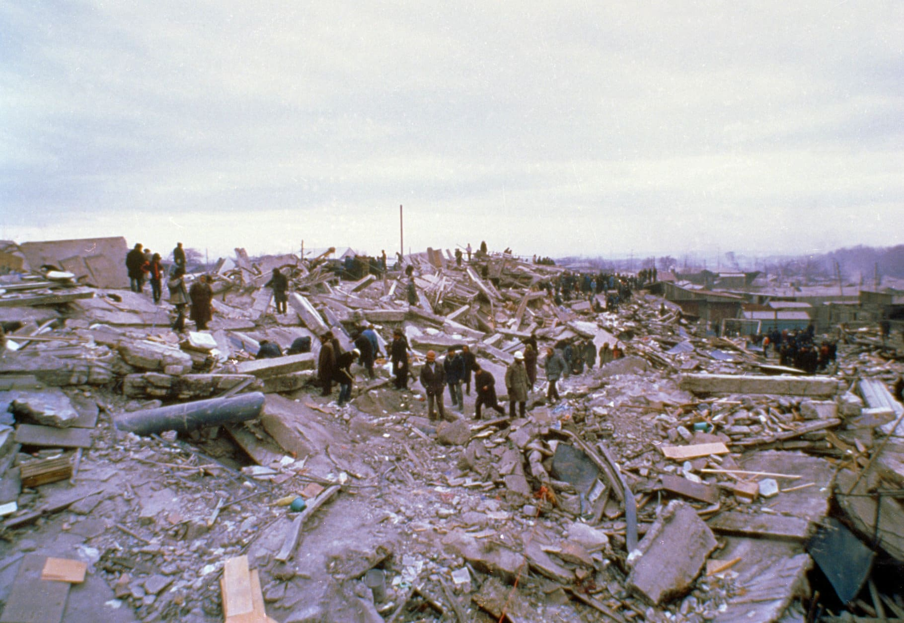 Rescue teams and survivors search for victims in the debris in Leninakan, Soviet Armenia, Dec. 12, 1988, after last week's devastating earthquake.  (AP Photo/Pool)