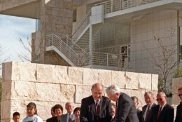 Robert E. Erburu, chairman of the board of J. Paul Getty Trust, left, and Harold M. Williams, president and CEO of J. Paul Getty Trust, cut the ribbon to commemorate the opening of the Getty Center on  Saturday, Dec. 13, 1997, in Los Angeles. Planned, designed and constructed over 13 years, the Getty Center's 24-acre campus on 110-acre site is both a museum and arts complex. The $1 billion hilltop monument to art and architecture is set to open to the public on Tuesday. (AP Photo/Mark J. Terrill)