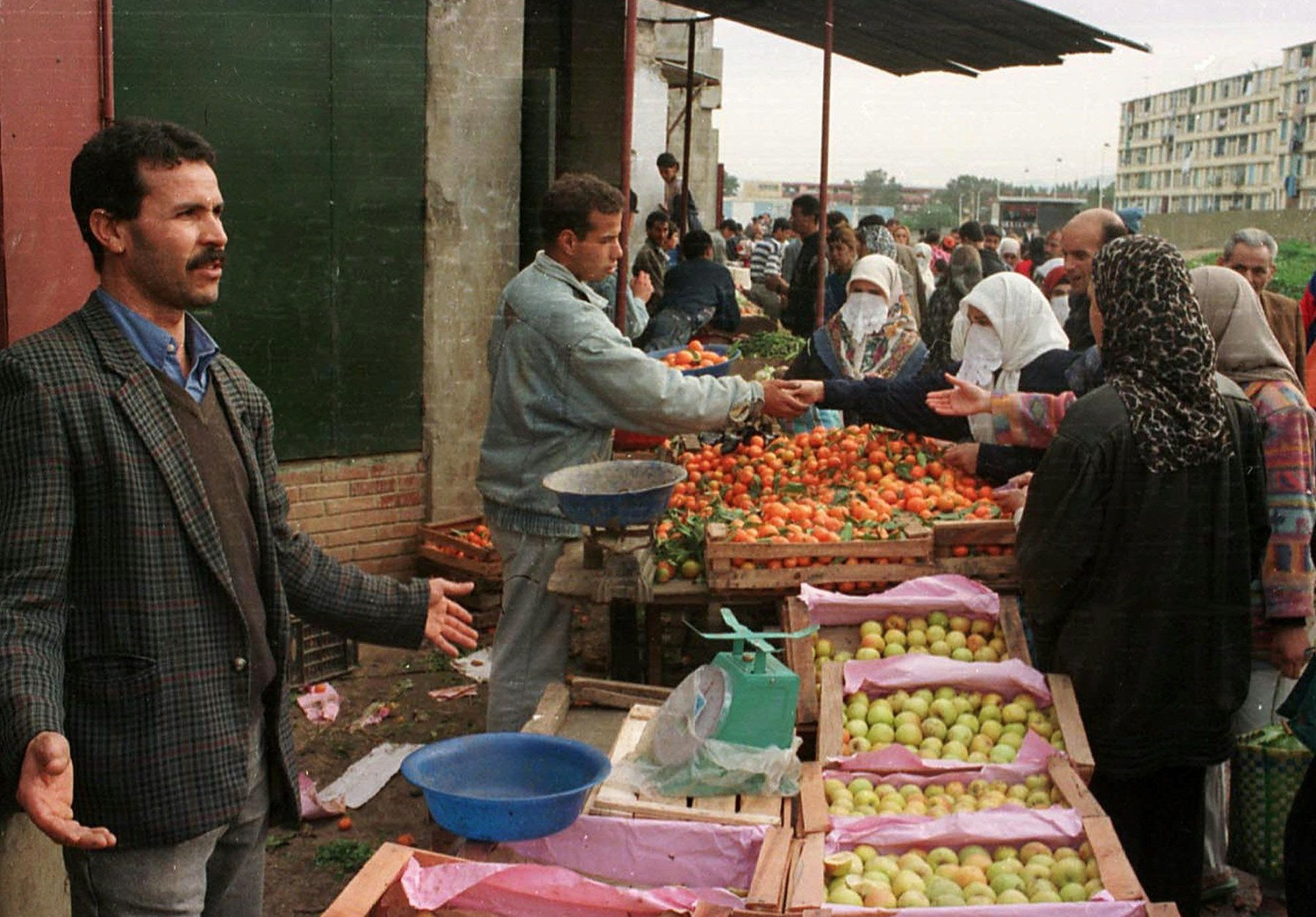 Algerians of the Badjarah district of Algiers go shopping in preparation for the holy month of Ramadan, Tuesday Dec. 30, 1997.  Road-side attackers and village raiders wielding knives and guns killed 58 people in Algeria in recent days according to witnesses and newspaper reports Tuesday. (AP PHOTO)