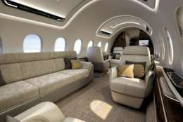 AS2 interior carries 12 in large-business-jet comfort up to 5,400 nautical miles (6,215 statute miles/10,000 km). Max. cruise speed is Mach 1.4, about 55 percent faster than today's fastest commercial jets, at a speed greater than 1,000 mph/1,600 kph. The AS2 saves as much as three hours across the Atlantic and more than five hours across the Pacific. Aerion is working with Lockheed Martin and GE Aviation to develop the AS2. (PRNewsfoto/Lockheed Martin Aeronautics Com)