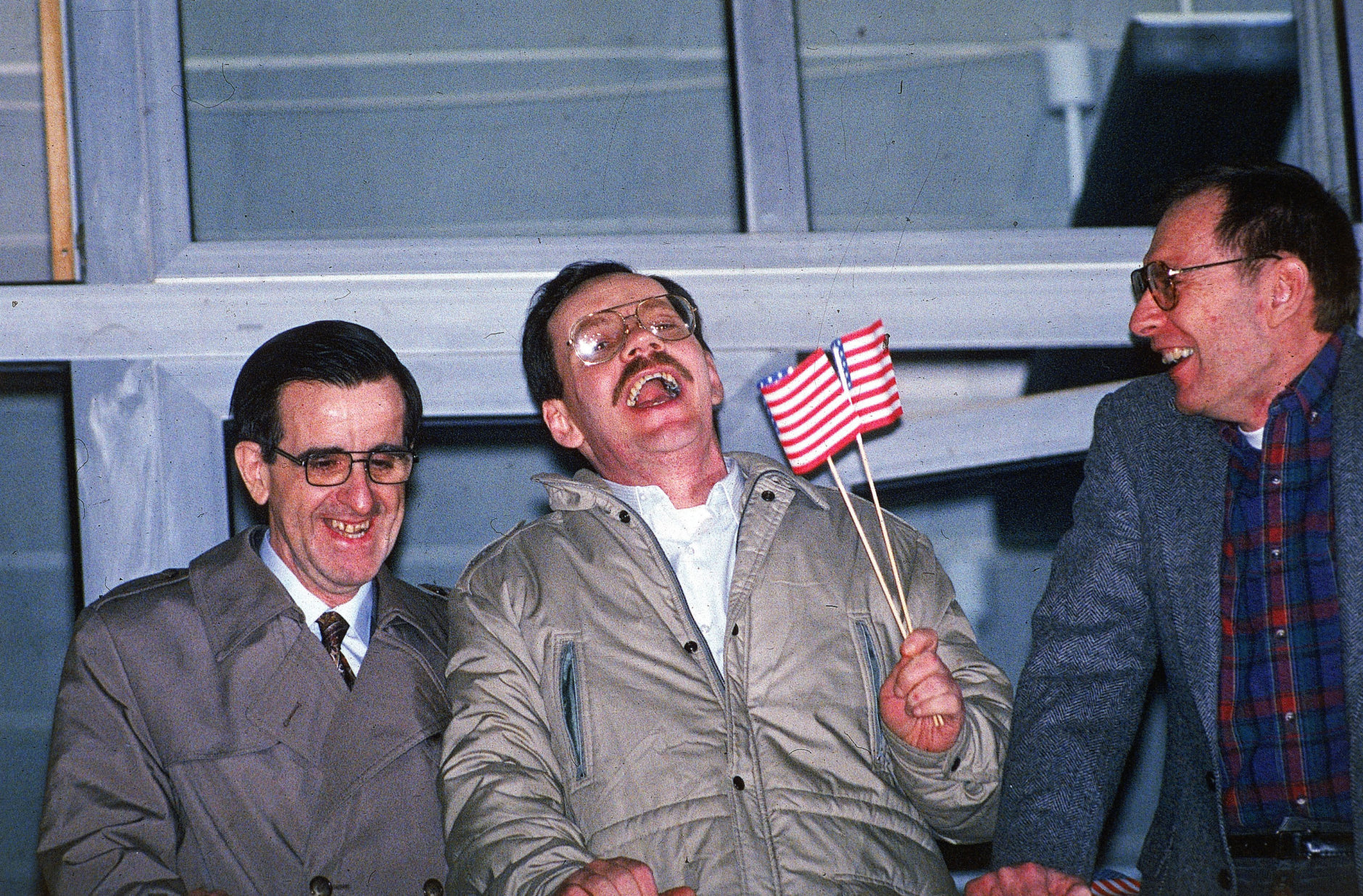 Three former U.S. hostages, from left, Joseph Cicippio, AP chief Middle East correspondent Terry Anderson, and Alann Steen enjoy a light moment shortly after Anderson's arrival at the Wiesbaden Air Force hospital early Thursday, Dec. 5, 1991.  (AP Photo/Kurt Strumpf)