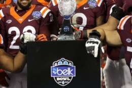 CHARLOTTE, NC - DECEMBER 29:  The Virginia Tech Hokies celebrate after defeating the Arkansas Razorbacks 35-24 in the Belk Bowl at Bank of America Stadium on December 29, 2016 in Charlotte, North Carolina.  (Photo by Streeter Lecka/Getty Images)