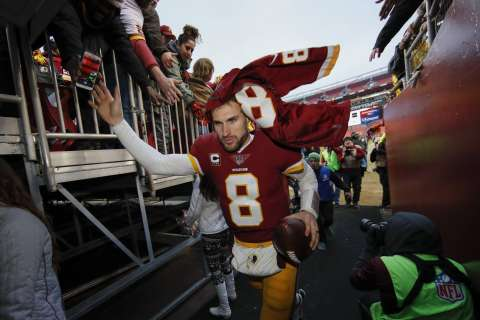 Cousins warms up his contract-signing hand, writes his farewell to DC