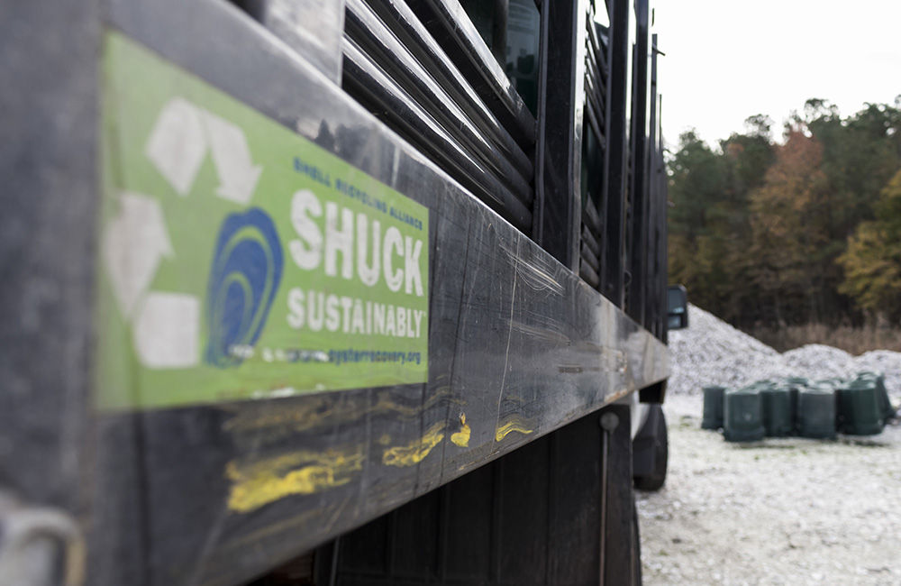 An Oyster Recovery Partnership sticker promoting sustainable oyster consumption practices on the Shell Recycling Alliance's truck, Nov. 9, 2017, at the group's shell pile in Grasonville, Md. Witzke and his colleagues recycle shell to bolster state and federally sponsored, large-scale oyster restoration in Chesapeake Bay tributaries. (Alex Mann/Capital News Service)