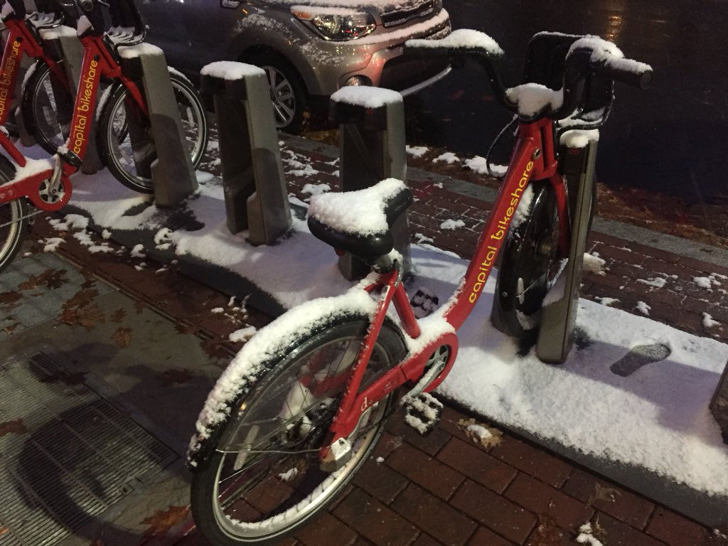 A snow covered bike at a Capital Bikeshare dock on Wisconsin Avenue in D.C. (WTOP/Patrick Roth)