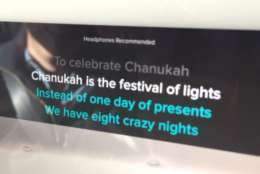 "Karaoke lyrics to ""The Chanukah Song"" scroll on the Lyft Merry Mode car's iPad. (WTOP/Kristi King)"