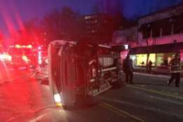 One person was in serious condition following a 4-vehicle crash that left one car overturned in Northwest D.C. Friday evening. (Courtesy D.C. Fire and EMS)