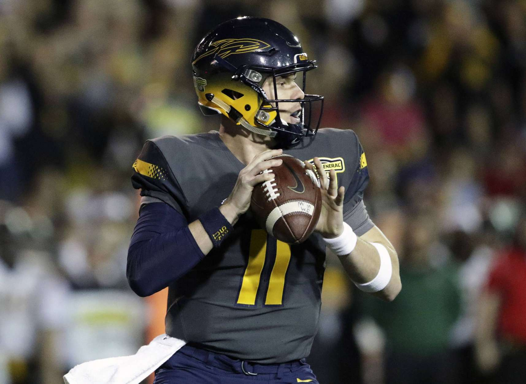 Toledo quarterback Logan Woodside looks to pass against Appalachian State in the first half during the Dollar General Bowl NCAA college football game Saturday, Dec. 23, 2017, in Mobile, Ala. (AP Photo/Dan Anderson)