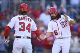 WASHINGTON, DC - OCTOBER 01:  Anthony Rendon #6 of the Washington Nationals celebrates hitting a three run home run in the first inning with Bryce Harper #34 during a baseball game against the Pittsburgh Pirates at Nationals Park on October 1, 2017 in Washington, DC.  (Photo by Mitchell Layton/Getty Images)