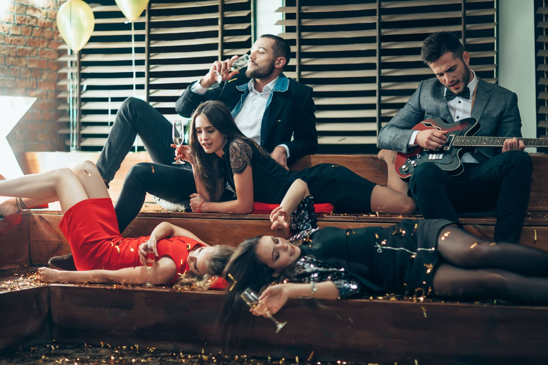 Friends enjoying party and celebrating together. New year, Birthday, Holiday Event concept