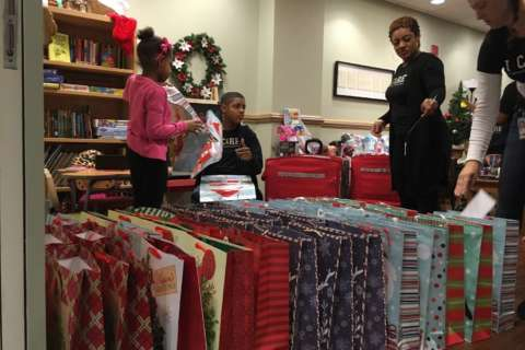 Local nonprofit delivers Christmas gifts to childhood cancer patients