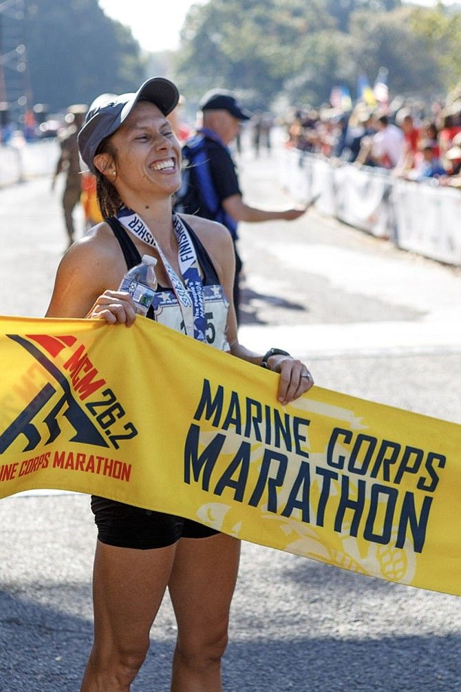 An gleeful Sarah Bishop grins after finishing the 2017 Marine Corps Marathon as the first place woman finisher.  (Courtesy Sarah Bishop)