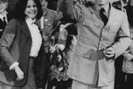 Lt. Commander John S. McCain III, a POW for over five years, waves to well wishers March 18, 1973 after arriving at Jacksonville Naval Air Station in Florida.  At left is his wife, and son Doug, who is on crutches after breaking his leg in a soccer game. McCain is the son of Adm. John S. McCain Jr, who commanded the U.S. Forces in the Pacific until his retirement. (AP Photo)