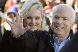 After his loss in the 2000 Republican primary, Sen. McCain ran again in 2008 and this time won the Republican nomination. In this photo McCain accompanied by his daughter Meghan McCain, waves to supporters as he enters a campaign rally at Defiance Junior High School in Defiance, Ohio., Thursday, Oct. 30, 2008. (AP Photo/Stephan Savoia)