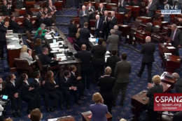 In this image from video provided by C-SPAN2, Sen. John McCain, R-Ariz. is is applauded as he arrives of the floor of the Senate on Capitol Hill in Washington, Tuesday, July 25, 2017 after announcing his cancer diagnosis. (C-SPAN2 via AP)