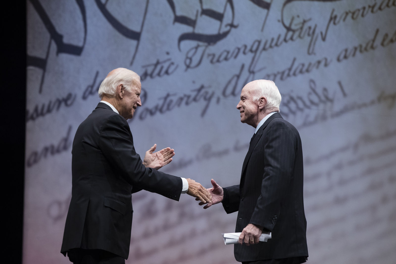 Sen. John McCain, R-Ariz., shakes hands with chair of the National Constitution Center's Board of Trustees, former Vice President Joe Biden after receiving the Liberty Medal in Philadelphia, Monday, Oct. 16, 2017. The honor is given annually to an individual who displays courage and conviction while striving to secure liberty for people worldwide. (AP Photo/Matt Rourke)