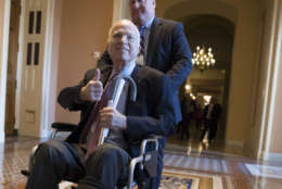 Sen. John McCain leaving a closed-door session with Republican senators on Dec. 1, 2017. McCain was hospitalized for side effects from his brain cancer treatment in December and announced he would miss the Senate vote on the Republican tax bill to spend the holidays at home in Arizona with his family. (AP Photo/J. Scott Applewhite, File)