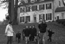 The Robert Kennedy family takes a walk at the Kennedy home in McLean, Va., on Dec. 30, 1959. From left: Mrs. Ethel Kennedy; Courtney, 3; Kathleen, 8; Joseph Patrick, 7; Robert Kennedy with one and a half-year-old Michael on his back; Bobby, 5; and David, 4. (AP Photo/Henry Griffin)