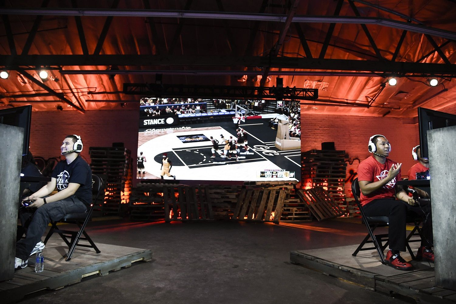 IMAGE DISTRIBUTED FOR NBA 2K - Team GFG, right, and team Drewkerbockers, left, seen at the NBA 2K16 Road to the Finals championship event on Wednesday, June 1, 2016, in Los Angeles. Two teams of gamers go head to head during a competition that merges simulation basketball with eSports for a shot at $250,000 and a trip to the 2015-2016 NBA Finals. (Photo by Dan Steinberg/Invision for NBA 2K/AP Images)