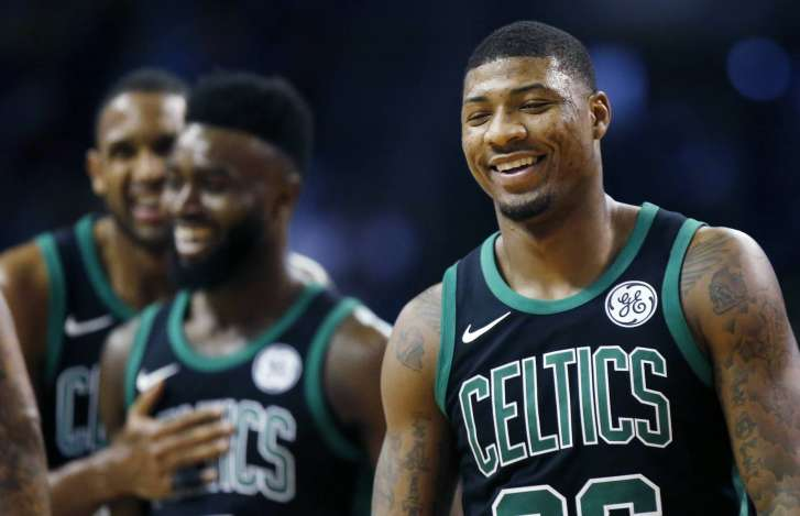 Irving helps NBA-leading Celtics burn Suns