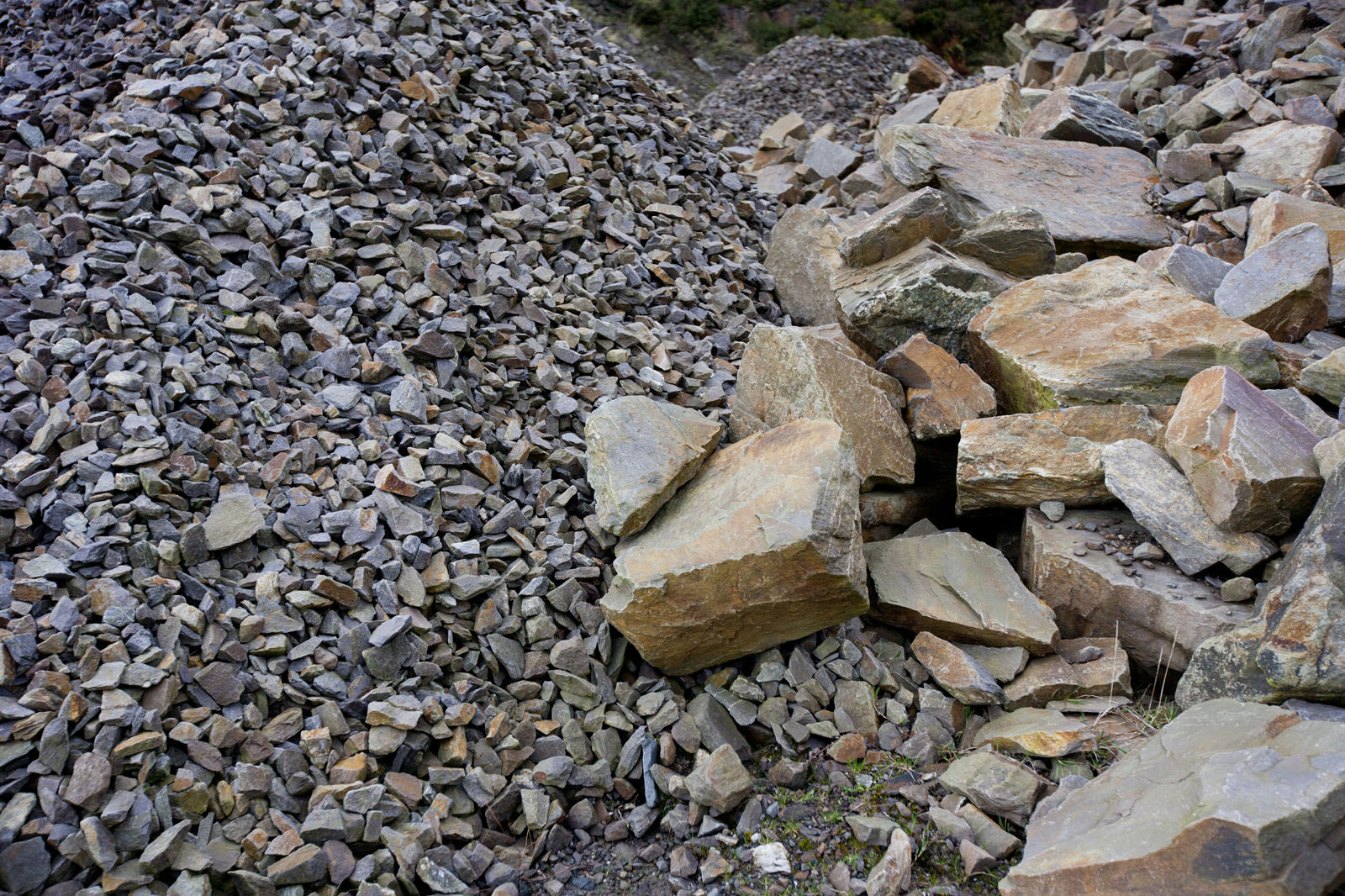 Close-up of different sized piles of rocks