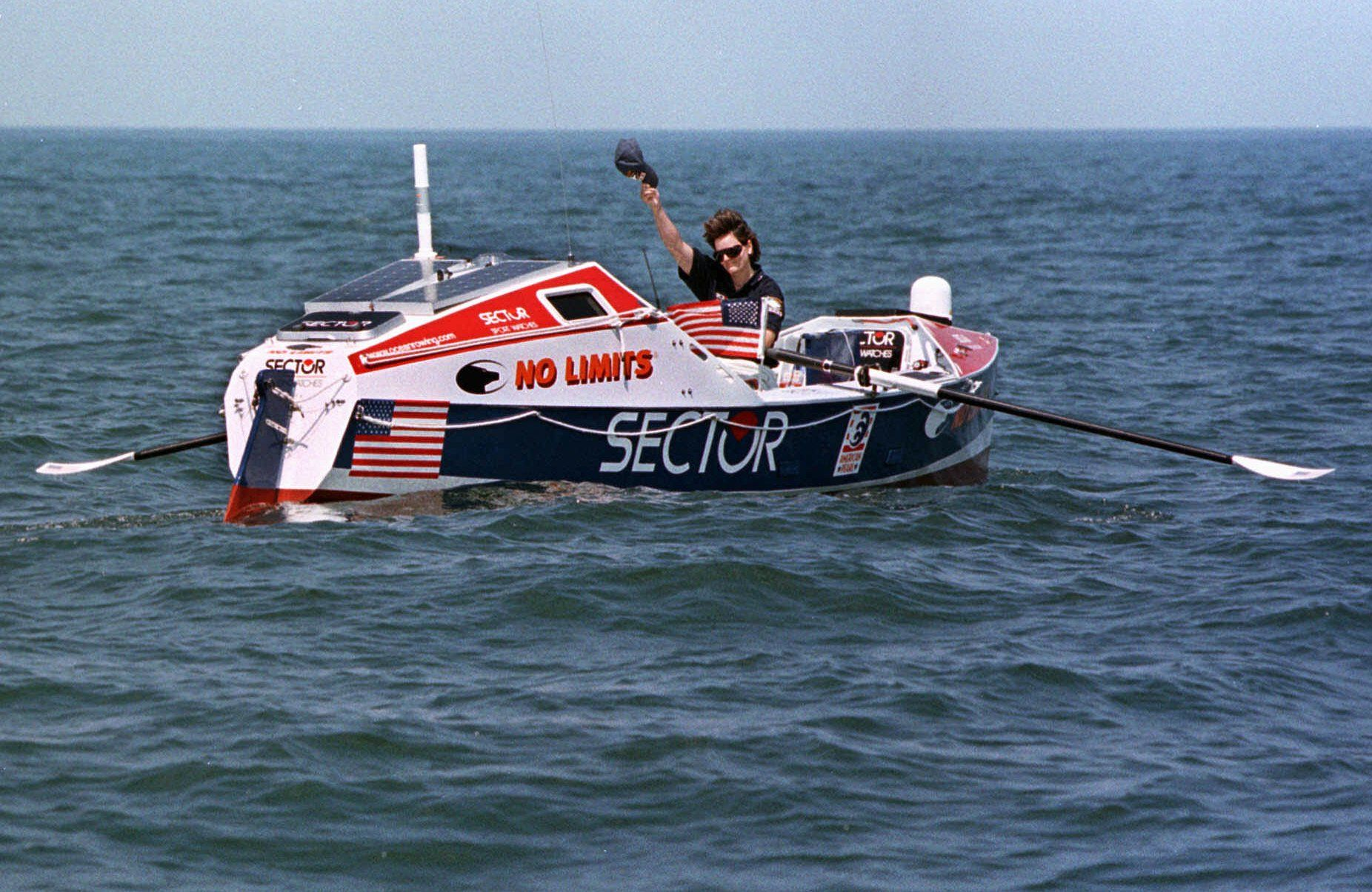 Tori Murden, of Louisville, Ky., attempting to become the first American and first woman to row solo across the North Atlantic Ocean, waves her hat as she hits open water Sunday, June 14, 1998, off North Carolina's Outer Banks, near Nags Head, N.C. Murden hopes to row 3, 635 miles as the crow flies and make the French coast in mid-September. (AP Photo/Bob Jordan)