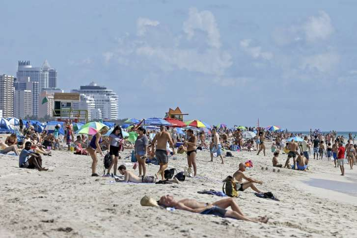 2 2017 File Photo Local Residents And Tourists Enjoy A Day At The Beach In South Area Of Miami Fla
