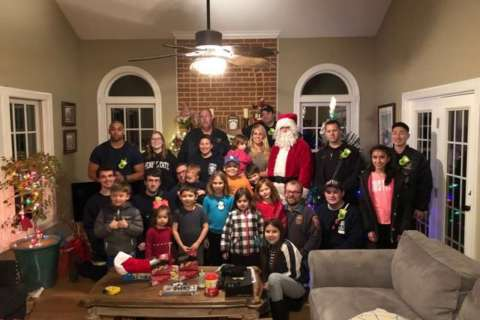 Family of fallen FBI agent visited by Santa, courtesy of Md. firefighters
