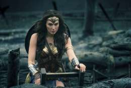 "This image released by Warner Bros. Entertainment shows Gal Gadot emerging from a trench during a WWI battle scene in ""Wonder Woman."" (Clay Enos/Warner Bros. Entertainment via AP)"