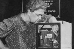 "Frances Glessner Lee was a woman in the male-dominated field of forensic science, but she turned to the traditionally-feminine hobby of crafts to help ""convict the guilty, clear the innocent, and find the truth in a nutshell.""   In this photo: Frances Glessner Lee with her Nutshell diorama, Dark Bathroom. (Image courtesy Glessner House Museum, Chicago, IL, via the Renwick Gallery)"