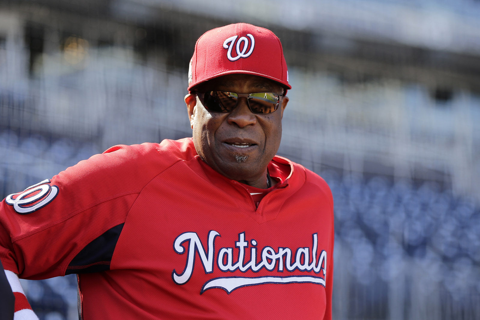 Washington Nationals manager Dusty Baker watches the team during baseball practice at Nationals Park, Wednesday, Oct. 4, 2017, in Washington. Game 1 of the National League Division Series against the Chicago Cubs is Friday. (AP Photo/Mark Tenally)