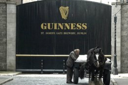 A man and his dray horse stop to adjust their load outside the gates of the Guinness Brewing Company in Dublin, Ireland Sept. 14, 2000.  The Hopstore at the sprawling brewery complex is  a popular stop for visitors to Dublin. (AP Photo/John Cogill)