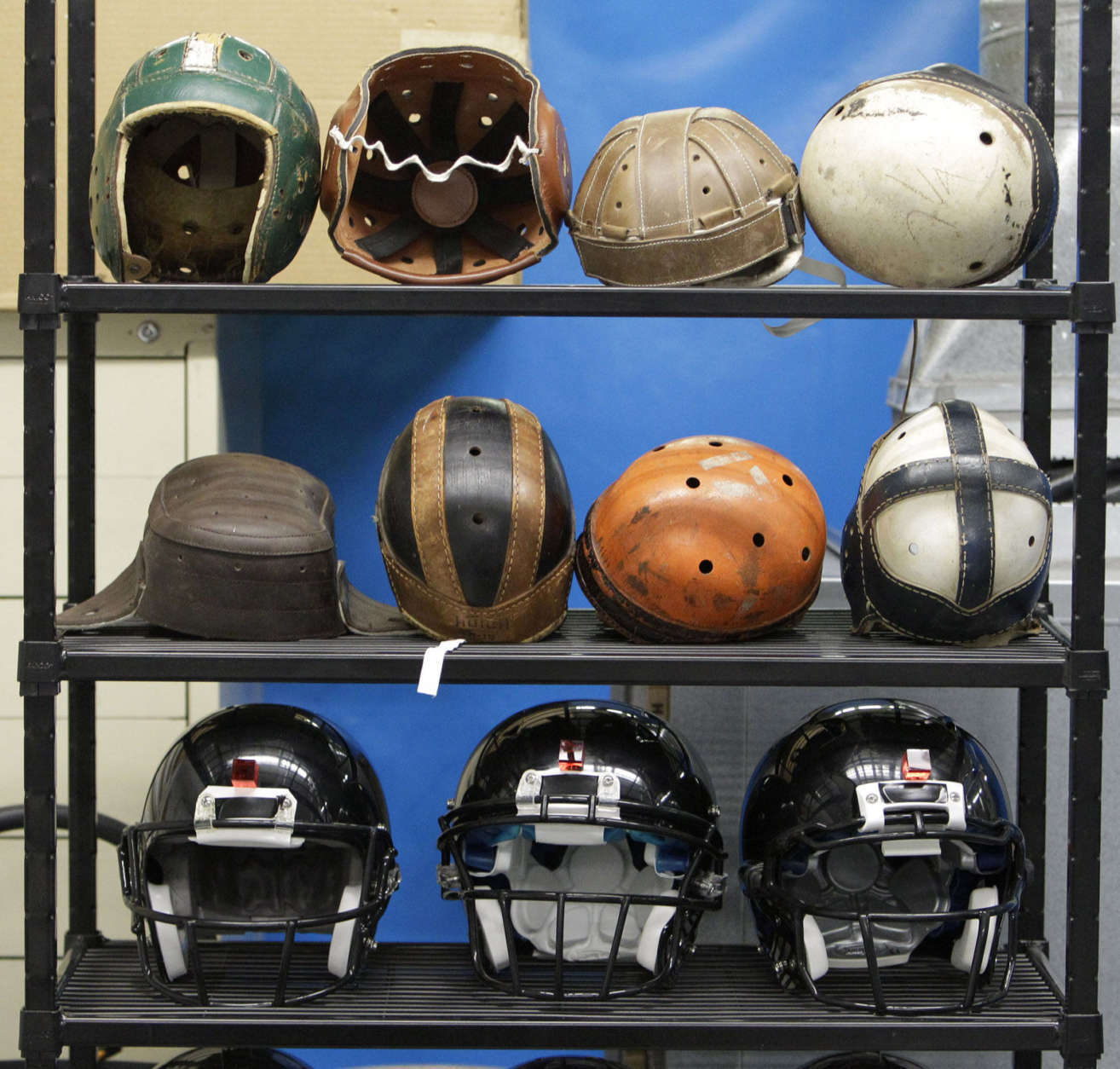 Helmets to be used for testing football helmet to helmet collisions sit in a rack at a laboratory in the Cleveland Clinic's Lutheran Hospital in Cleveland Thursday, Sept. 23, 2010. Under the direction of Spine Research Laboratory director Lars Gilbertson, the Clinic will soon begin testing to research concussions and other sports-related head and neck injuries. (AP Photo/Mark Duncan)
