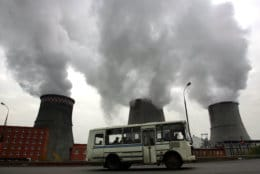 Steam and smoke rise from cooling towers on the outskirts of  Moscow, Friday, Oct. 22, 2004. Russia's lower house of parliament ratified the Kyoto Protocol on global warming Friday, moving the sweeping environmental pact to the threshold of taking effect and marking a major victory in the worldwide campaign to cut down on greenhouse gases. (AP Photo/Ivan Sekretarev)
