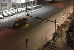 A snow plow works on the streets of Rockville, Maryland, on Saturday, Dec. 30, 2017. (WTOP/John Aaron)