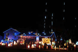 This home in Centreville, Virginia, plays a realistic Santa film on a loop in a side window. (Courtesy Holly Zell)