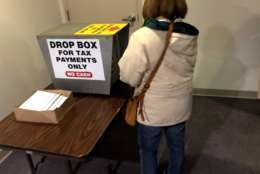 Interest is high in prepaying county property tax,  ahead of a new tax law. Taxpayers in Fairfax Co. can drop off a check in the county government building.  (WTOP/Neal Augenstein)