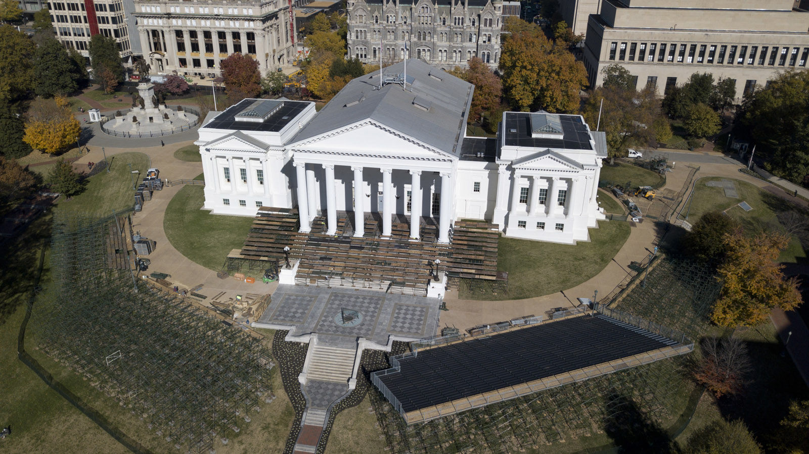 Bleachers and a reviewing stand are erected in preparation for the January inauguration of Virginia Governor-elect Ralph Northam at the Capitol in Richmond, Va., Monday, Nov. 20, 2017. (AP Photo/Steve Helber)