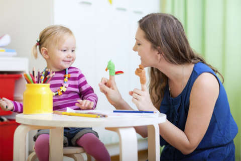 Virginia backs off making day care workers speak English