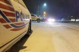 Snow coats a police cruiser in Northwest D.C. Thursday morning. (WTOP/William Vitka)