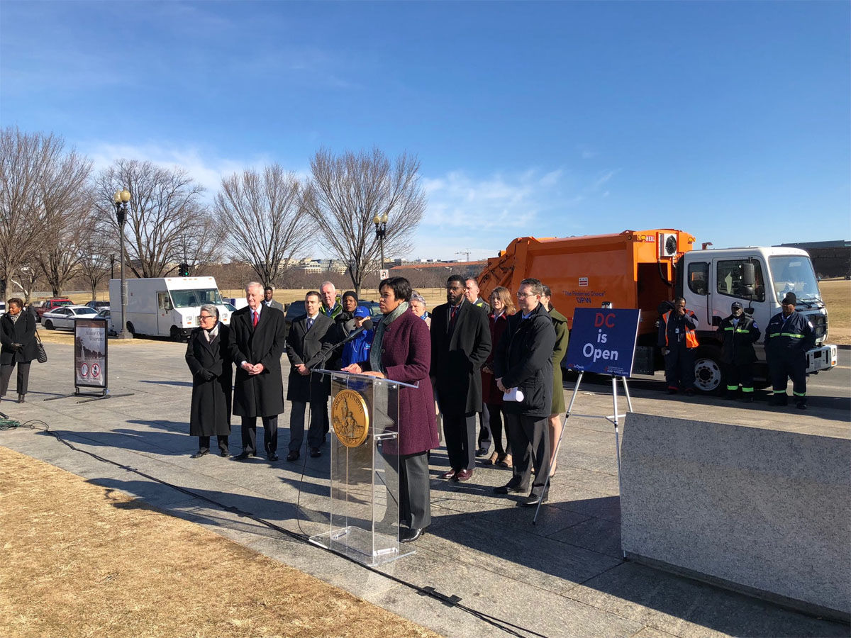 D.C. Mayor Muriel Bowser held a news conference on the National Mall to assure residents the District government would remain open and continue to provide uninterrupted service no matter what happens on Capitol Hill. (WTOP/John Aaron)