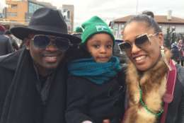 The Osuchukwu family smiles for a photo at the MLK Peace Walk and Parade. (WTOP/Kristi King)