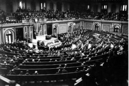U.S. President Woodrow Wilson reads the terms of the German Armistice to Congress in Joint session, and announces the end of World War I, in Washington, D.C., on Nov. 11, 1918. The peace plans proposals are outlined in the 'fourteen points.' (AP Photo)
