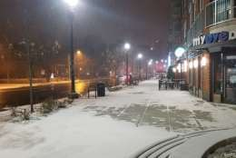Snow falls amid the frigid conditions in Northwest D.C. (WTOP/William Vitka)