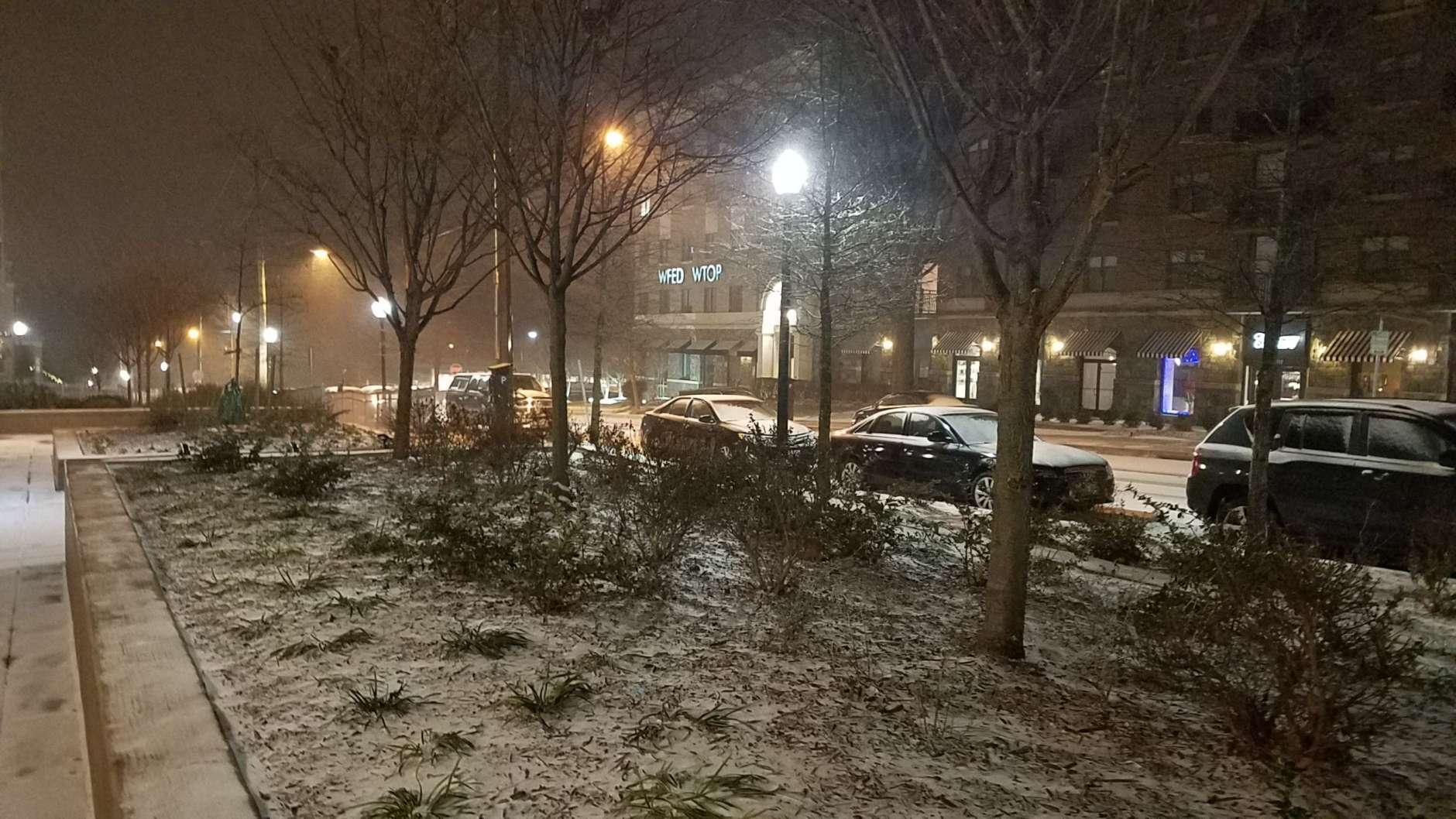 Snow falls outside the Glass-Enclosed Nerve Center in Northwest D.C. (WTOP/William Vitka)