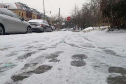 Footprints in the light snow that fell in Northwest D.C. Jan. 17. (WTOP/William Vitka)