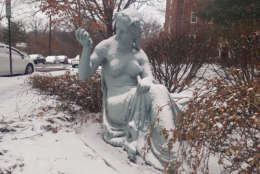 Snow sits on a statue in Northwest D.C. (WTOP/William Vitka)