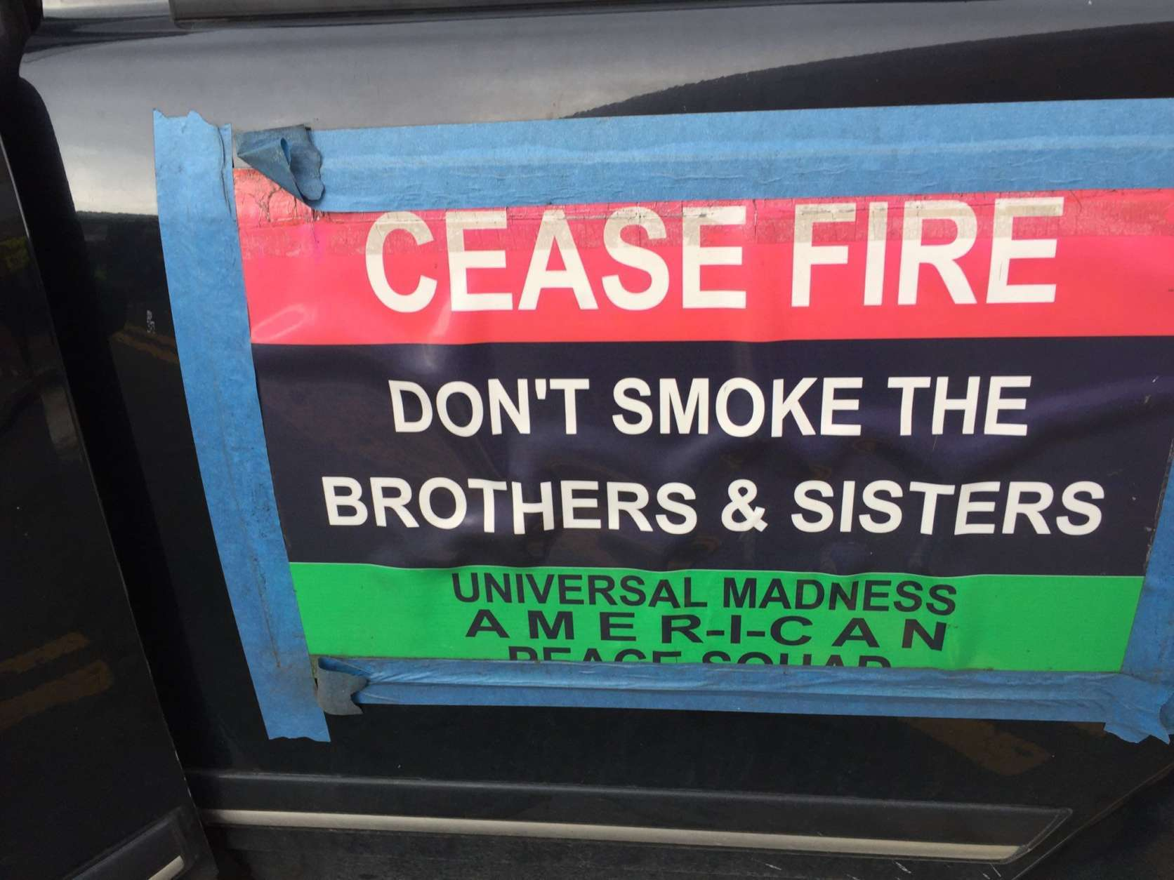"""A sign at the MLK Peace Walk and Parade which states, """"Cease fire: Don't smoke the Brothers and Sisters."""" (WTOP/Kristi King)"""