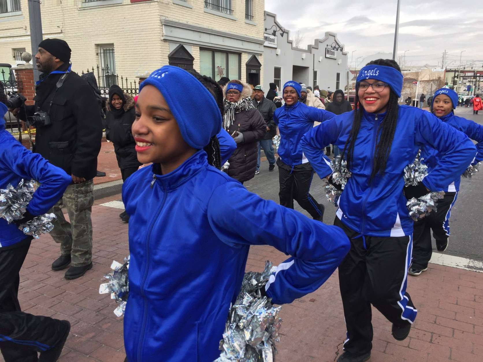 A squad of cheerleaders do as cheerleaders do at the MLK Peace Walk and Parade. (WTOP/Kristi King)