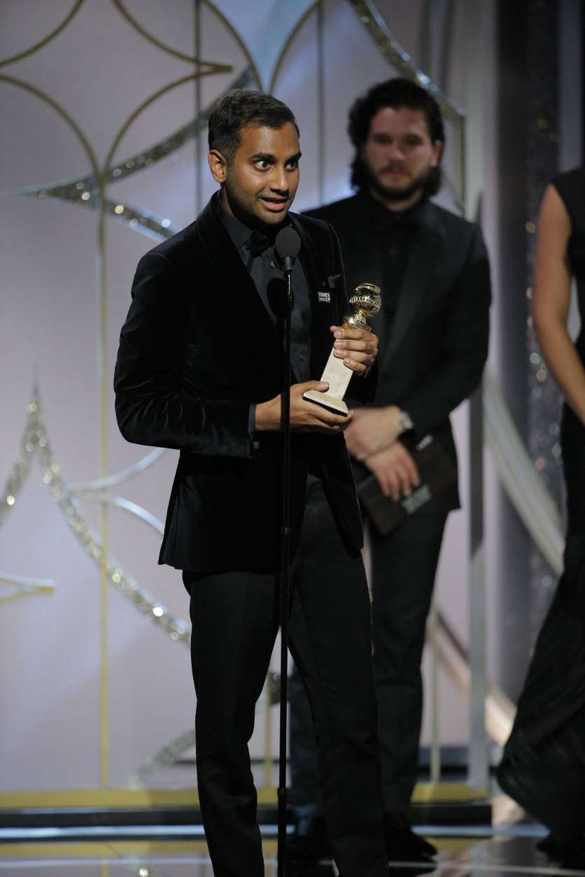 "This image released by NBC shows Aziz Ansari accepting the award for best actor in a comedy series for his role in ""Master of None,"" at the 75th Annual Golden Globe Awards in Beverly Hills, Calif., on Sunday, Jan. 7, 2018. (Paul Drinkwater/NBC via AP)"